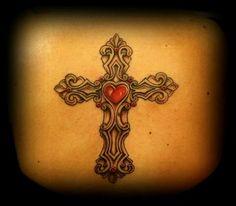 Elegant cross tattoo