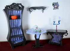 Oh my god, Tim Burton Nightmare Before Christmas themed bookshelf and night stand. Small table, candlabra and shelf. I REALLY Love this! It would fit perfectly in my grey/purple bedroom! Ugh! I need it!