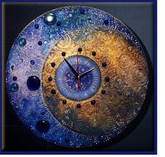 Natalya Polekh's celestial clock is a beautiful complexity of texture and motif with shine and shimmer, as seen on the Polymer Arts blog, www.thepolymerarts.com
