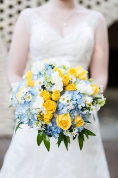 A sweet summer wedding with a blue and yellow lovebird theme // photos by Lindsay Fauver Photography: http://www.LindsayFauverPhotography.com || see more on http://www.artfullywed.com