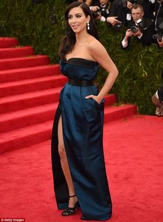 The right stuff: Kim's Kardashian Met Gala gown was a strapless blue number with high slit in front that flattered her curves