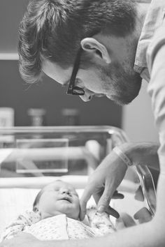 Dad leaning over baby in the hospital bassinet is a MUST!