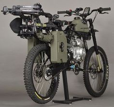 The Survival Bike: Black Ops Edition ~ hits the trail with a compound crossbow, fuel storage, shovel, tomahawk, harpoon, blade saw, climbing gear, lights and a smattering of tools and knives. To keep you on the correct (read: covert) path, there's a handlebar mount for that trusty smartphone or GPS unit needed to navigate. When the apocalypse arrives (zombie or otherwise), you'll need to be prepared for anything.