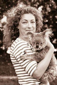 Alex Kingston cuddling a koala. You're welcome.