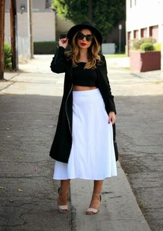 Trench coat paired with an a-line midi skirt and metallic heels. #ootd