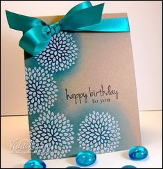 Vicki Dutcher/All I Do Is Stamp  The card is on sept. 18th on her blog.  It's embossed flowers in white then sponged blue over top. Her blog is wonderful tons of wonderful ideas.