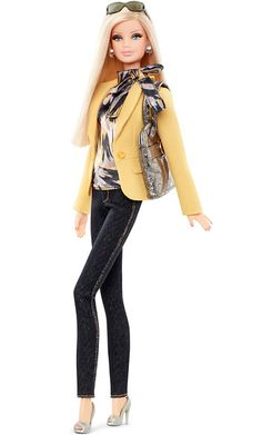 "Barbie Gets a Tim Gunn Makeover: Exclusive First LookBarbie's Casual LookBarbie is ready to ""make it work!"" Dressed in her favorite skinny jeans, the $30 doll works a patterned blouse, yellow blazer, metallic purse, and must-have smartphone. $30 at barbiecollector.com and Target stores in August."