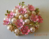 Flower pin brooch. Faux pearls, pink rhinestones and enamel gold plate metal.