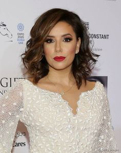 chignon desperate housewives star eva longoria parker. Black Bedroom Furniture Sets. Home Design Ideas