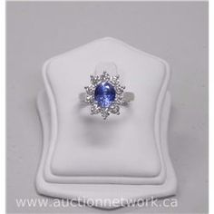 Ladies 18kt White Gold Diamond Custom Made Ring. It contains 1 oval faceted cut Sapphire (4.40cts) a