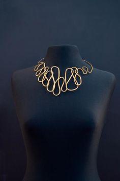 Necklace | Melanie Rhodes. Hand hammered brass.