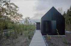 format elf nestles dark barn-shaped houses into bavarian forest