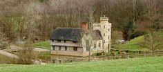 John and Jo Mew have not just built a remarkable moated medieval style manor house from scratch using a combination of reclaimed materials and innovation