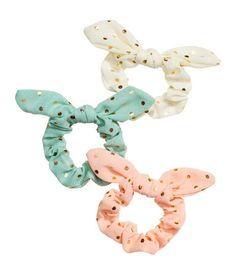 Turquoise/dotted. Hair elastics with a bow.