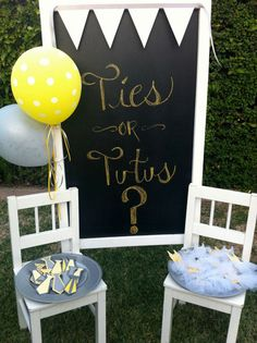 tutus and neck tie theme gender reveal baby shower party with chevron pattern chalkboard entry sign << I love this idea! You could do this for the game where if you say the secret word you lose your pin!