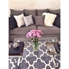 I love quatrefoil patterns. And I think I want a quatrefoil rug for the living room. Neutral. Would gray go with dark brown floor? (Linoleum floors that look like hardwoods.) Hmmm. Depends on couch color. Maybe a pop of color on the rug.