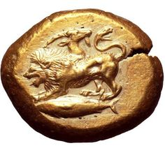 Extremely Rare Ancient Chimera CoinThis is an electrum stater from the ancient city of Kyzikos, Mysia, circa 550-500 BC. It has a chimera above a tunny fish which was the civic badge of Kyzikos. The reverse is a quadripartite incuse square. This near...