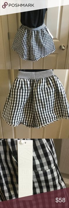 Black and white check shorts with fringe! Full-almost a skirt with elastic waistband. A white tank would also be great! Or YELLOW!!! kaelen Shorts Skorts
