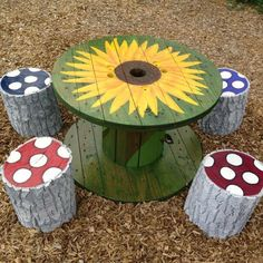 Painted cable spool table for the patio, but leave the chairs unpainted, topped with spar varnish.