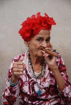Cuban cigar woman in Old Havana >>> This woman looks like a lot of fun! I hope I can visit cuba soon, the people always look so full of life!