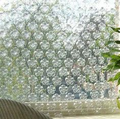 Beautiful outdoor privacy screen using the bottoms of water bottles... We like this. Found on - Repurposed Recycled Reused Reclaimed Restored —