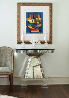 A low-hanging frame works above a pedestal table - Traditional Home®
