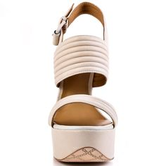 Get the latest from L.A.M.B. with Mabelle. A soft white leather makes up this chic and retro inspired style. A 5 1/2 inch thick heel and 1 3/4 inch sturdy platform completes this summer sandal.
