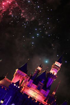 remember...dreams come true - awesome photo of the fireworks behind the Disneyland castle.