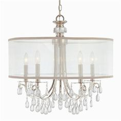 Modern Glam Shaded Crystal Chandelier - 5 Light (2 Finishes)  A sleek modern chandelier is adorned with dazzling crystals under a sheer drum shade for the ultimate in style and sophistication. Select Olde Brass (with gold shade) or Chrome (with platinum shade).