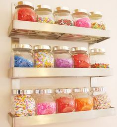 Sprinkle Storage Rack --- I use these Rajtan jars from Ikea for storing buttons and such in my craft room. didn't even think about doing this for sprinkles