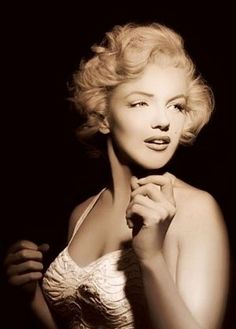 Marilyn Monroe. I love that whomever colored this kept it pretty much black and white, sepia but colored her eyes Blue.