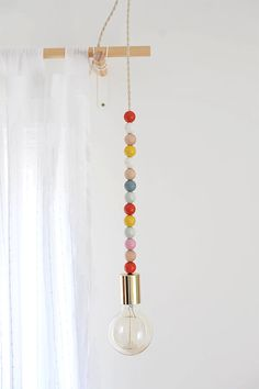 DIY Wooden Bead Pendant Light, tutorial via A New Bloom