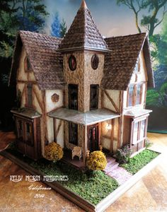 1/2 Scale Fairfield Gone Tudor by By kellyannmo from the Greenleaf Dollhouse Website. She always does awesome kit bashes,