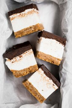 these s'mores bars sandwich a thick layer of fluffy homemade vanilla bean marshmallow in between graham cracker crust and salted dark chocolate ganache!