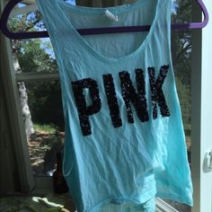 XS active top pink from Victoria's Secret blue Really cute light blue active top by pink from Victoria's Secret. Size XS, brand name is in black sequins, large openings on sides for working out. Short length top, not quite crop top but definitely short. PINK Victoria's Secret Tops Tank Tops