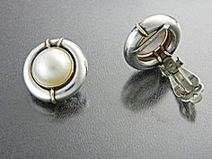 Earrings14K Gold Acents Sterling Silver Mabe Pearl Clip Beautiful 14K Gold Accents with Sterling Silver Clip Earrings Signed NR 14K and SS. The Earrings are 7/8 of an inch.