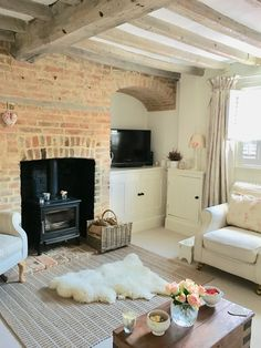 I love all of the neutral shades in this cozy living room. The beamed ceiling just makes this perfect! Cottage Lounge, Cottage Living Rooms, Cottage Interiors, Cottage Homes, Apartment Living, Living Room Decor, Living Spaces, Country Interiors, Cozy Living
