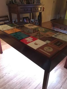 Cigar box table with glass top and multi color LED undercarriage.