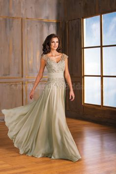 Jasmine Bridal Mother of the Bride/Groom Jade Style J175001 in Champagne Gold.  A head turner for your next special occasion in this Tiffany chiffon dress. Look elegant in this classic V-neckline and A-line skirt silhouette with beautiful ruching on the neckline and beading detail on the sash.