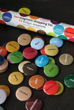 Shopping List Fridge Magnets 35 Magnets - Brighten up your fridge with this set of 35 brightly coloured, 25mm button fridge magnets packed in a Smartie-like tube. Each magnet is printed with an essential grocery item as a shopping list reminder.  This is not only useful but they look beautiful - also a great gift idea.