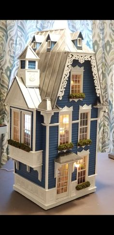 Miniature House made out of Cardboard I call the Chateau Blue.  greggsminiatureimaginations.blogspot.com