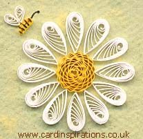 Daisy @cardinspirations.co.uk  the center is apparently a crimped strip coiled.