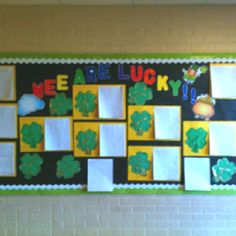 "St. Patrick's Day bulletin board ""Wee  are lucky"" -glittered 4 leaf clover with student name and ""If I caught a leprechaun"" writing"