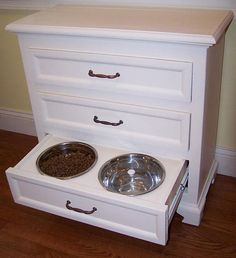 A nice way to get organized. Turn a dresser into a feeder. Hide the bowls in the bottom and the food in the top. Then you can use the middle drawer to store brushes, toys, and pet shampoo.