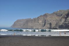 Playa de los Guios is a small, 'hidden' beach in Los Gigantes, Tenerife, Canary Islands. It's next to the harbor, behind the waves breaker so it's mostly calm with managable waves. It's under the cliff, full of apartments and next to an apartment building built in historical style. As it's small it's mostly packed, but you are able to find your spot and peace. It's not really for snorkeling any more as there is danger of falling rocks on the left end of the beach.