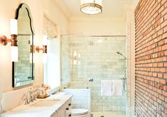 Epic Bathroom Interior Design with Small Vanity Design and Brick Wall Paint Color and Round Shaped Pendant Lamp and Glass Door Completed plus Chrome Faucet and Tub Shower Idea and White Sink Brick Bathroom, White Vanity Bathroom, Small Vanity, Bathroom Sconces, Modern Bathroom, Master Bathroom, Vanity Design, Bath Design, Tile Design