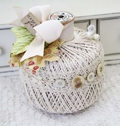 PUMPKIN IDEA, I WOULD USE ORANGE TWINE OR CROCHET THREAD WITH BLACK TRIM AND CONTRASTING BUTTONS AND EMBELLISHMENTS. COULD USE GREEN, PURPLE, OR EVEN BLACK ALL WITH CONTRASTING EMBELLISHMENTS.
