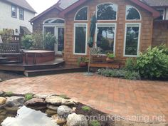 Landscape Design LED Lighting Paver Patio Renovation Water Garden Pond in Rochester NY by Acorn Ponds & Waterfalls To learn more abou Diy Patio, Backyard Patio, Patio Ideas, Outdoor Ideas, Outdoor Decor, Patio Lighting, Lighting Ideas, Outdoor Water Features, Pond Waterfall