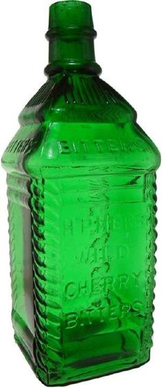 This H.P. Herb Wild Cherry bitters bottle with embossed cherry tree sparkles in a beautiful shade of green. The cabin shape with tooled top helped this brilliantly colored bottles go for seven thousand dollars in an August 2009 American Bottle Auctions sale.