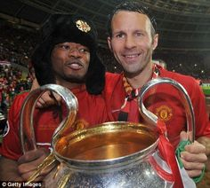 Ryan Giggs (R) and Patrice Evra of Manchester United hold the trophy after the UEFA Champions League Final match between Manchester United and Chelsea at the Luzhniki Stadium on May 21, 2008 in Moscow